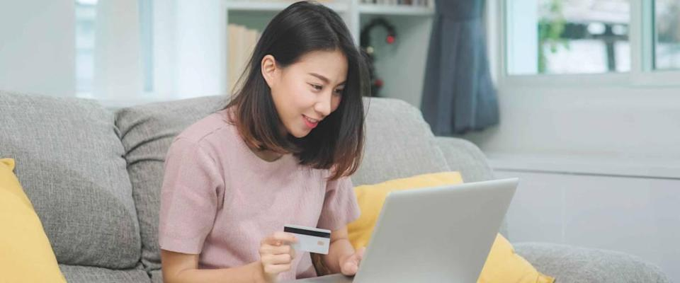 Asian woman using laptop and credit card shopping ecommerce,