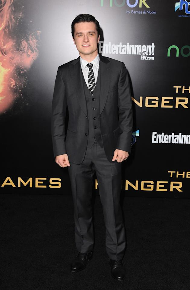 "Josh Hutcherson arrives at the world premiere of ""The Hunger Games"" in Los Angeles, California."