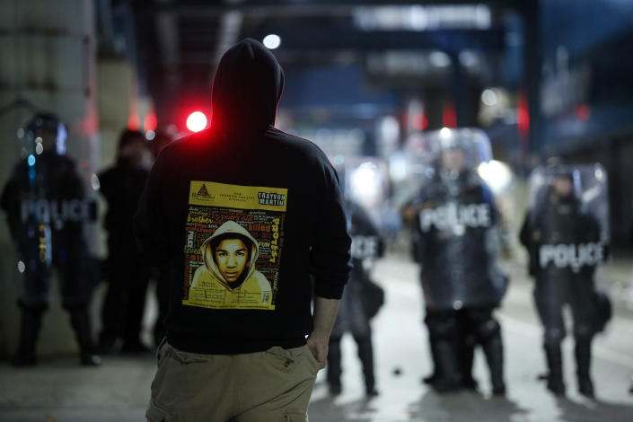 A demonstrator protesting the fatal police shooting of Walter Wallace Jr. wears a hoodie with a photo of Trayvon Martin on the backside. (Photo by Joshua Lott/The Washington Post via Getty Images)