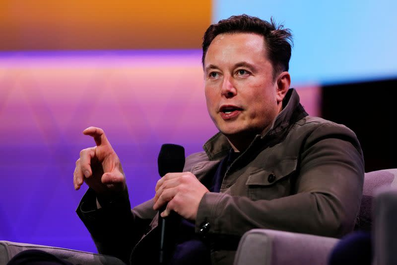 FILE PHOTO: Tesla CEO Elon Musk gestures during a conversation at the E3 gaming convention in Los Angeles