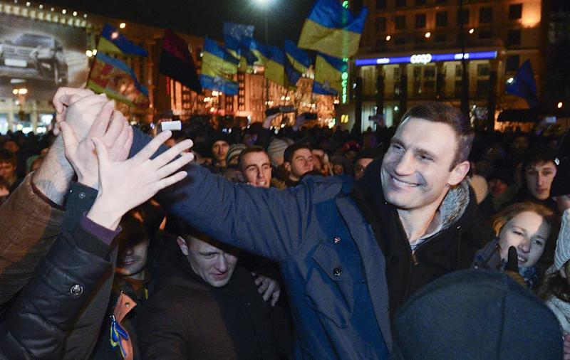 FILE - In this Tuesday, Nov. 26, 2013 file photo Ukrainian lawmaker and chairman of the opposition party Udar (Punch), WBC heavyweight boxing champion Vitali Klitschko attends a rally in support of Ukraine's integration with the European Union at European Square in Kiev, Ukraine. Towering over his fellow protest leaders, reigning world heavyweight boxing champion Vitali Klitschko has emerged as Ukraine's most popular opposition figure and has ambitions to become its next president. As massive anti-government protests continue to grip Ukraine, Wednesday Dec. 4, 2013, Klitschko is urging his countrymen to continue their fight to turn this ex-Soviet republic into a genuine Western democracy. (AP Photo/Andrew Kravchenko, File)