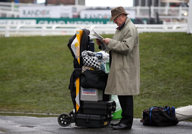 Horse Racing - Grand National Festival - Aintree Racecourse, Liverpool, Britain - April 13, 2018 General view of a bookmaker setting up during the Grand National Festival REUTERS/Andrew Yates