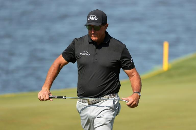 Five-time major winner Phil Mickelson shared the lead with South African Louis Oosthuizen after 36 holes at the PGA Championship