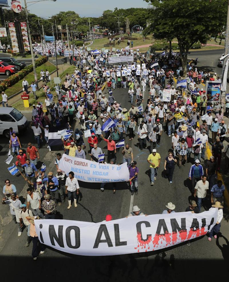 "Demonstrators hold a banner reading ""no to the Canal"" as they take part in a march against the construction of an inter-oceanic canal in Managua on December 10, 2014"