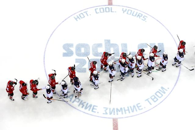 SOCHI, RUSSIA - FEBRUARY 21: Canada and the United States shake hands after Canada defeated the United States 1-0 during the Men's Ice Hockey Semifinal Playoff on Day 14 of the 2014 Sochi Winter Olympics at Bolshoy Ice Dome on February 21, 2014 in Sochi, Russia. (Photo by Martin Rose/Getty Images)
