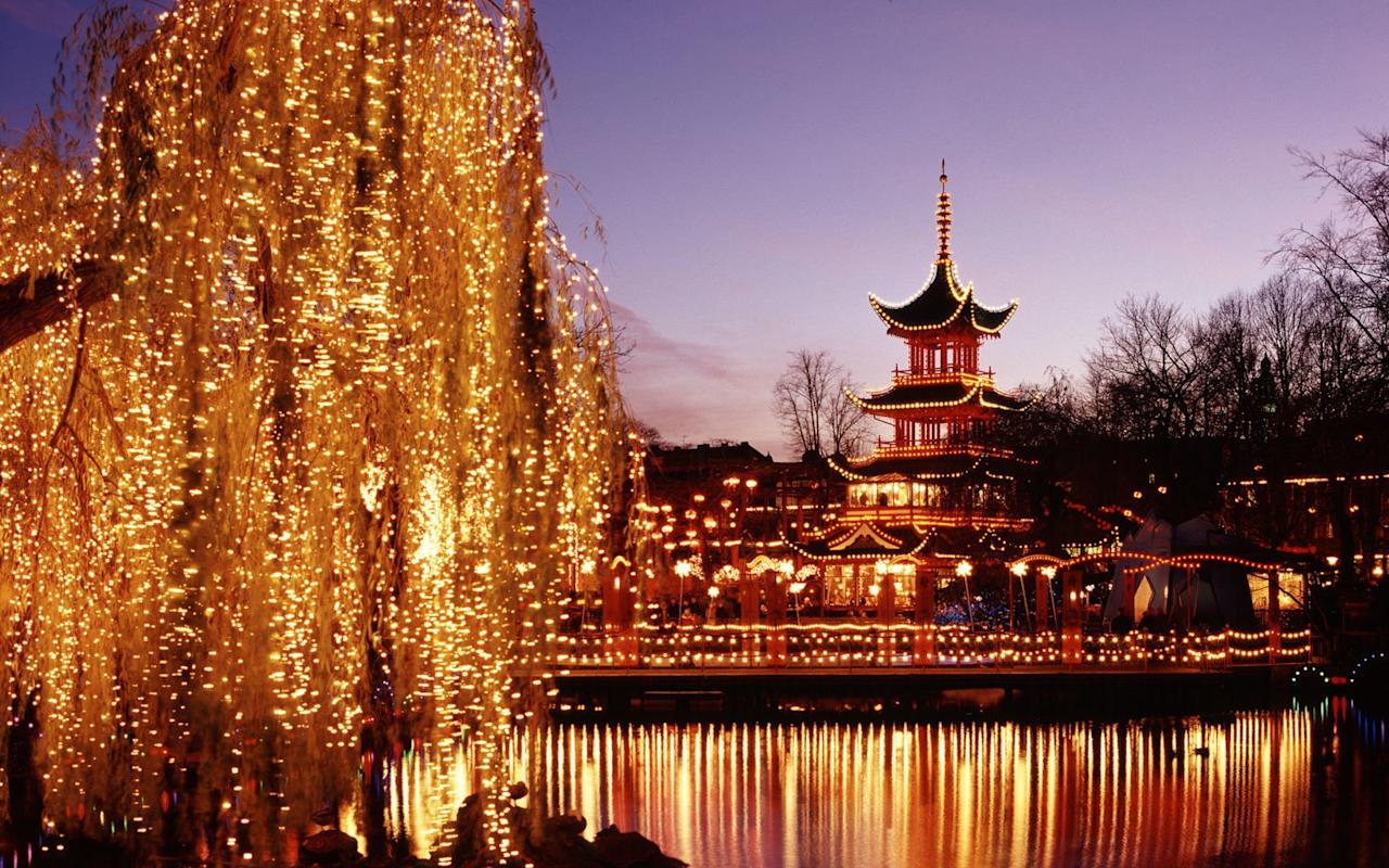"""<p>Copenhagen celebrates Jul (as in """"yuletide"""") with a Christmas crafts market and surfeit of light-bedecked Christmas trees in the city's famed historic amusement park, <a href=""""https://www.travelandleisure.com/articles/copenhagens-evolving-tivoli-gardens"""" title=""""Copenhagen's Evolving Tivoli Gardens"""">Tivoli Gardens</a>. Nearly four miles of lights are artfully hung in patterns dictated by Tiffany's head designer, while hundres of strands are draped on the lakeside willows. Join the Danes in warding off the cold with <em>æbleskiver</em> (iced doughnuts with black currant jam) and glogg, a steaming hot mulled red wine laden with raisins, almonds, cinnamon sticks, and cloves—all of which are steeped in aquavit or schnapps. There's also a crafts market installed along a canal in the historic Nyhavn district; try to visit it between 5 and 6pm weekdays to catch the town crier.</p> <p><strong>Look For:</strong> Pixie-like <em>nisser</em>, tiny household elves that infest Denmark around Christmas clad in clogs, red shirts, and pointed red caps. More fickle than their cousin Santa, they <em>might</em> bring presents if you leave them bowls of porridge in the attic; if you forget, they'll visit all kinds of mischief instead.</p> <p><strong>Dates:</strong> Mid-Nov.–late Dec.; closed early Jan.</p> <p><strong>For More Info:</strong> <a href=""""http://www.visitcopenhagen.com"""" target=""""_blank"""" title="""" Copenhagen"""">visitcopenhagen.com</a></p>"""