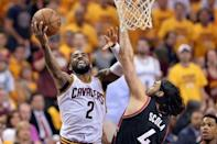 May 25, 2016; Cleveland, OH, USA; Cleveland Cavaliers guard Kyrie Irving (2) drives to the basket as Toronto Raptors forward Luis Scola (4) defends during the second half in game five of the Eastern conference finals of the NBA Playoffs at Quicken Loans Arena. The Cavs won 116-78. Mandatory Credit: Ken Blaze-USA TODAY Sports