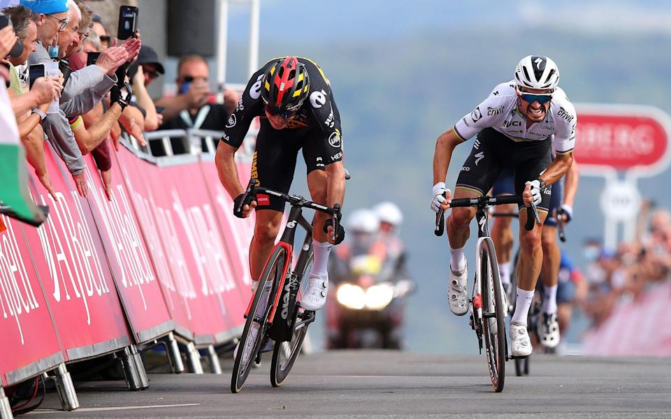 Wout Van Aert of Belgium and Team Jumbo - Visma sprints at finish line to win the stage ahead of Julian Alaphilippe of France and Team Deceuninck - Quick-Step during the 17th Tour of Britain 2021, Stage 4 a 210km stage from Aberaeron to Great Orme, Llandudno 130,6m - lex Livesey/Getty Images
