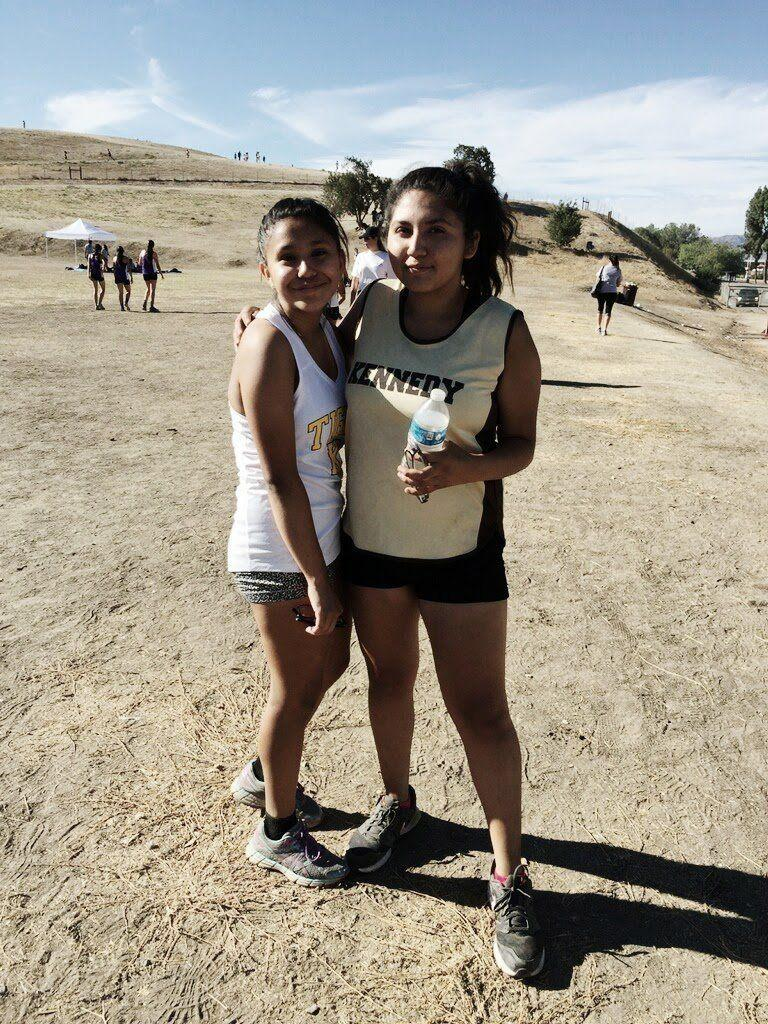 Citlaly Ortega, right, with her friend Reanna Casarez at a cross-country meet in October 2016.