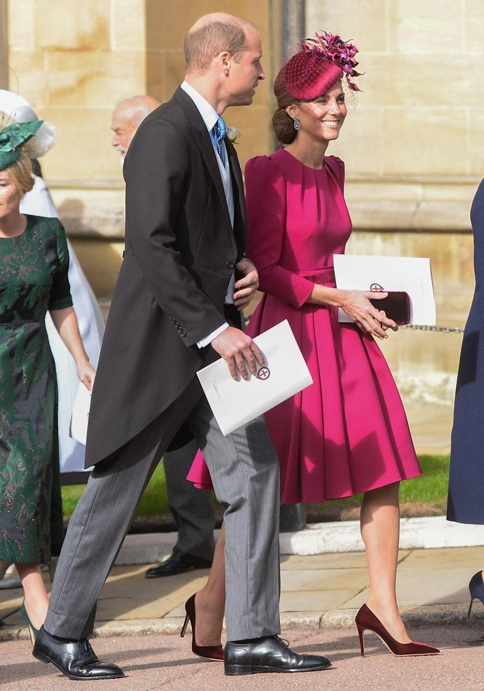 <p>Always elegant and expertly put together, Kate Middleton looked gorgeous in her Alexander McQueen dress with strong shoulders and pleated A-line skirt which she wore to Princess Eugenie's wedding at Windsor Castle. </p>