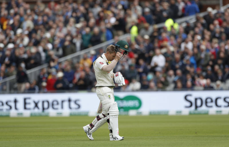 Australia's David Warner leaves the field after being dismissed during day one of the fourth Ashes Test cricket match between England and Australia at Old Trafford in Manchester, England, Wednesday, Sept. 4, 2019. (AP Photo/Rui Vieira)