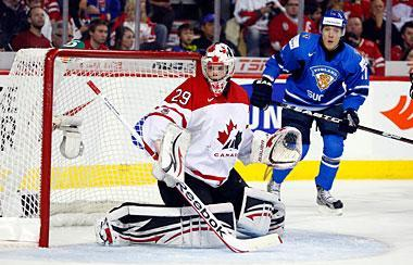 Team Canada's goalie Mark Visentin, left, follows the play as Finland's Markus Granlund looks on during first period World Junior Championships bronze medal game hockey in Calgary, Alta., Jan. 5, 2012
