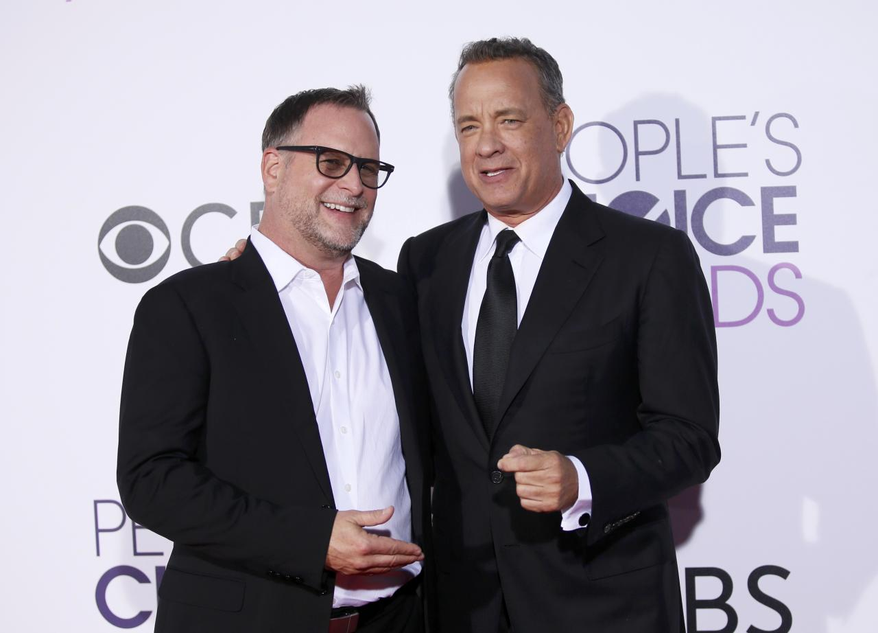 Actors Dave Coulier (L) and Tom Hanks arrive at the People's Choice Awards 2017 in Los Angeles, California, U.S., January 18, 2017.  REUTERS/Danny Moloshok