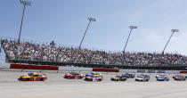 Tyler Reddick (8) leads the field past fans in the Turn 1 grandstands during the NASCAR Cup Series auto race at Darlington Raceway, Sunday, May 9, 2021, in Darlington, S.C. (AP Photo/Terry Renna)
