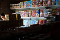 """A woman searches for goods in a """"bodegon"""" named """"Mini Walmart"""" in Puerto Cabello"""
