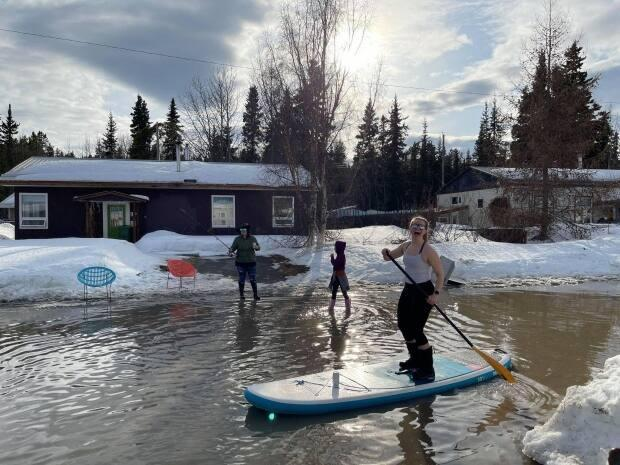 Some Whitehorse residents made the most of the spring melt on their street this week. Emergency officials in Yukon are watching closely for any potential problems associated with flooding this year. (Shawna Kostelnik - image credit)