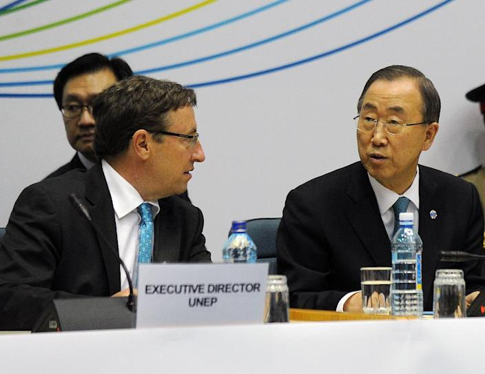 UN environment programme head Achim Steiner (L) and UN Secretary General Ban Ki-moon attend the closing ceremony of the UN Environment Assembly (UNEA), in Nairobi, on June 27, 2014 (AFP Photo/Tony Karumba)