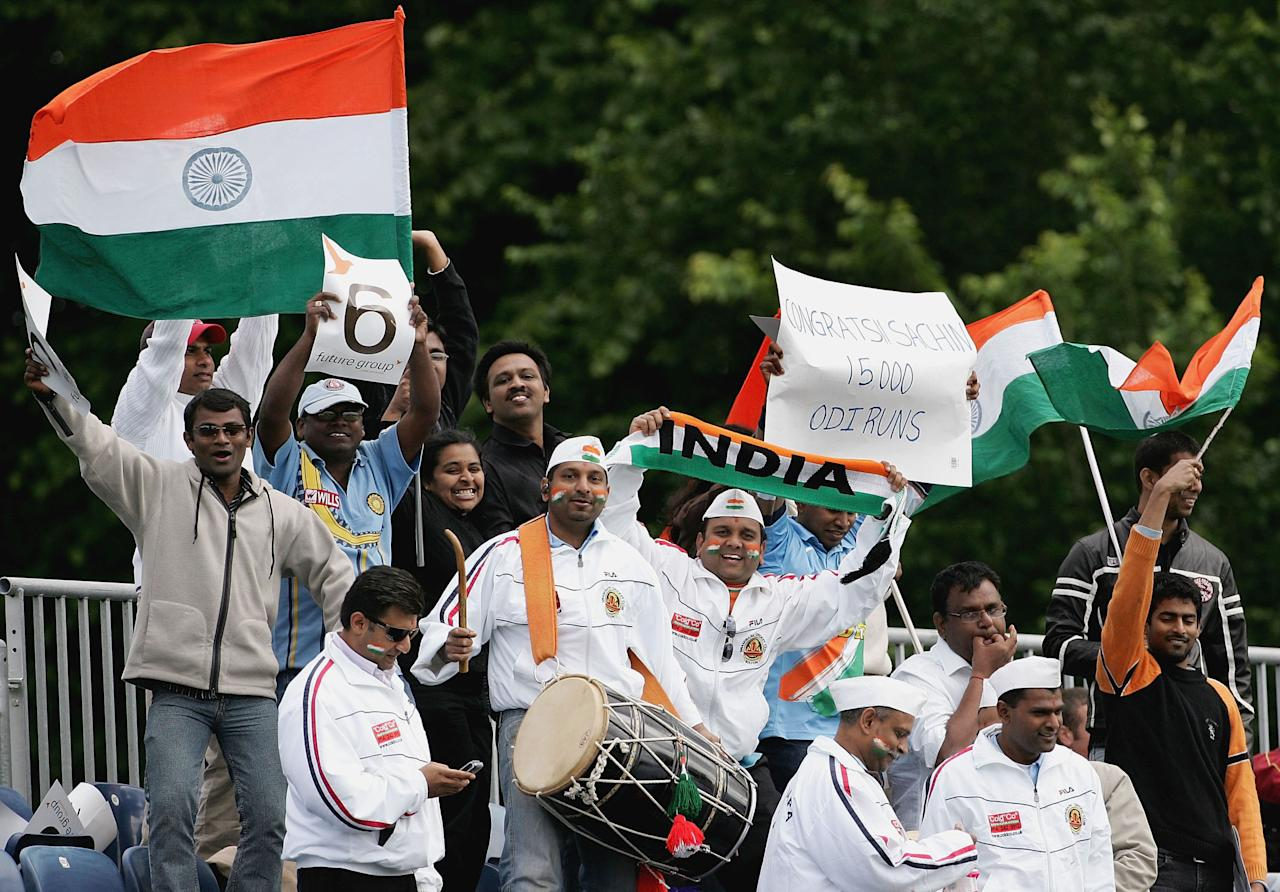 BELFAST, UNITED KINGDOM - JUNE 29:  Fans celebrate Sachin Tendulkar of India's 15,000th ODI career run during the second One Day International match between South Africa and India at the Civil Service Cricket Club in Stormont on June 29, 2007 in Belfast, Northern Ireland.  (Photo by Hamish Blair/Getty Images)