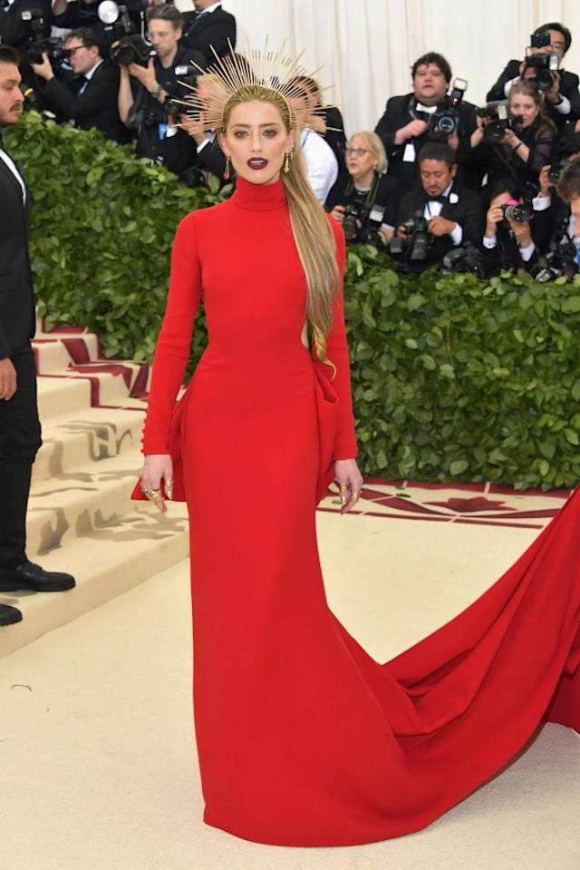 <p>Heard achieved a full look with a red Carolina Herrera gown and gorgeous gold headpiece. (Photo: Getty Images) </p>