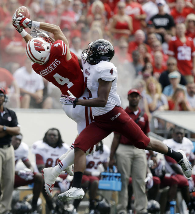 Massachusetts's Randall Jette, right, breaks up a pass intended for Wisconsin's Jared Abbrederis during the second half of an NCAA college football game Saturday, Aug. 31, 2013, in Madison, Wis. Wisconsin won 45-0. (AP Photo/Morry Gash)
