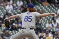 Los Angeles Dodgers' Dustin May throws during the first inning of a baseball game against the Milwaukee Brewers Saturday, May 1, 2021, in Milwaukee. (AP Photo/Morry Gash)