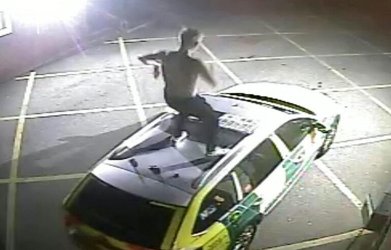 Police have released CCTV to appeal for the identity a man who jumped up and down on a rapid response ambulance. (SWNS)