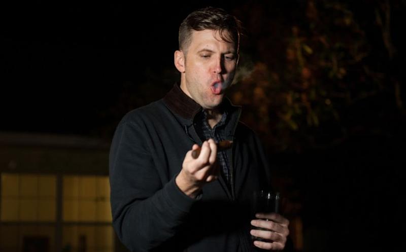 Richard Spencer tries to act cool while smoking a cigar.