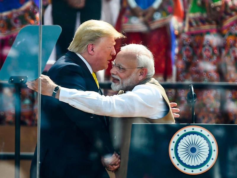 President Donald Trump shakes hands with India's Prime Minister Narendra Modi during 'Namaste Trump' rally: AFP via Getty Images