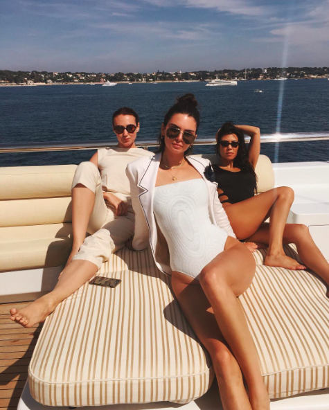 "<p>""Meet us at the lido deck,"" Kendall captioned a snap of herself, sister Kourtney, and a friend chilling in their bathing suits. Kendall sported a stunning white one-piece for the occasion, while Kourt donned a black suit with dramatic cut-out details. For some inexplicable reason, Kendall decided to put a suit jacket over her suit — but she's a supermodel, so it kind of works. (Photo: Kendall Jenner via Instagram) </p>"