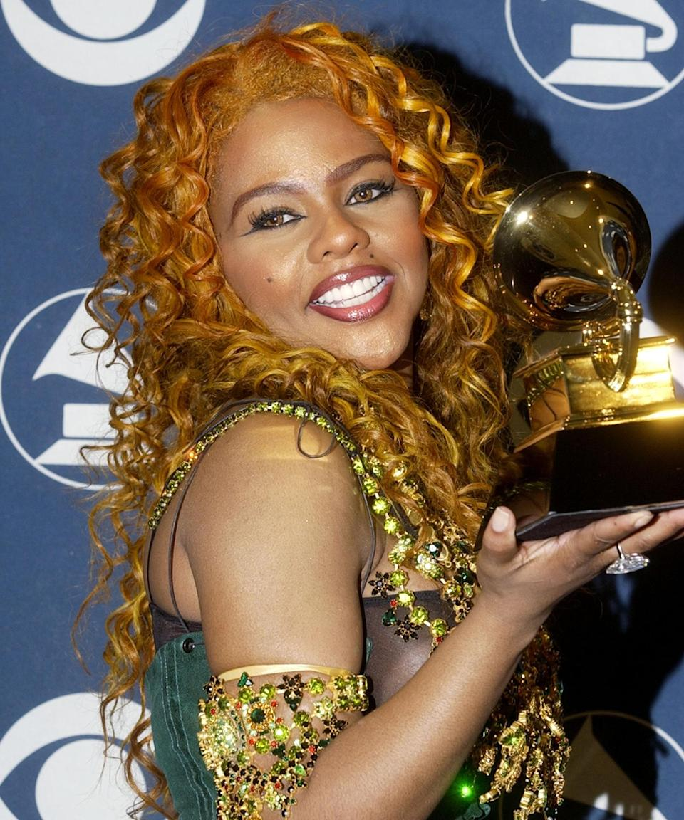 """<strong><h2>Lil' Kim</h2></strong><br>Kim isn't afraid of experimenting with her hair color, but it was the fiery orange-red in the early 2000s that had people stanning the hardest. Now, the <a href=""""https://www.refinery29.com/en-us/copper-hair-color-ideas"""" rel=""""nofollow noopener"""" target=""""_blank"""" data-ylk=""""slk:copper hue"""" class=""""link rapid-noclick-resp"""">copper hue</a> is back — and one of the biggest trends of the moment.<span class=""""copyright"""">Photo: SGranitz/WireImage.</span>"""