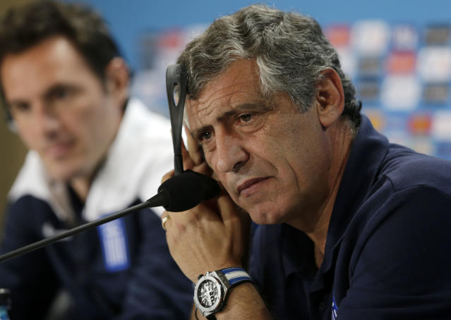 Greece's head coach Fernando Santos listens with earphones to the media at a press conference on the day before the group C World Cup soccer match between Colombia and Greece at the Mineirao Stadium in Belo Horizonte, Brazil, Friday, June 13, 2014. (AP Photo/Fernando Vergara)