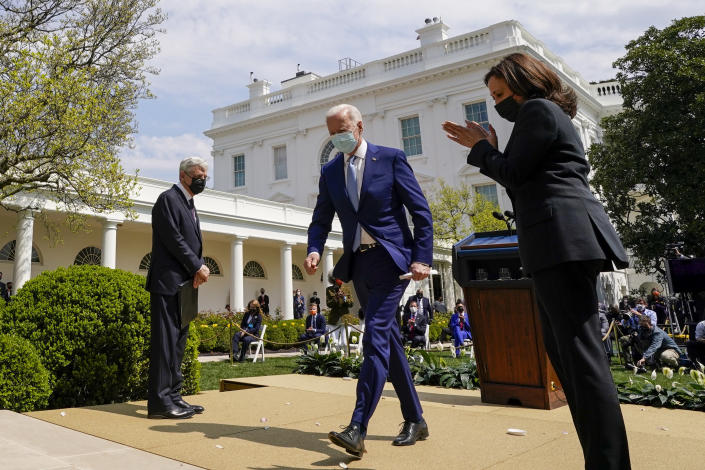President Joe Biden, accompanied by Vice President Kamala Harris, right, and Attorney General Merrick Garland, left, departs after speaking about gun violence prevention in the Rose Garden at the White House, Thursday, April 8, 2021, in Washington. (AP Photo/Andrew Harnik)