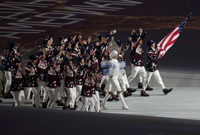 Flag-bearer Todd Lodwick of the U.S. leads his country's contingent during the athletes' parade at the opening ceremony of the Sochi 2014 Winter Olympic Games February 7, 2014. REUTERS/Mark Blinch (RUSSIA - Tags: OLYMPICS SPORT)