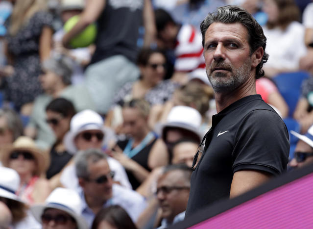 Serena Williams' coach Patrick Mouratoglou watches her first round match against Germany's Tatjana Maria at the Australian Open tennis championships in Melbourne, Australia, Tuesday, Jan. 15, 2019. (AP Photo/Kin Cheung)