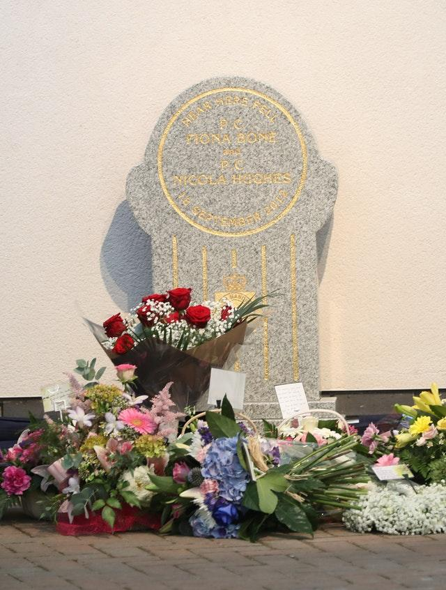 Flowers laid at a memorial stone in Mottram, Tameside, unveiled to honour Pc Fiona Bone, 32, and Pc Nicola Hughes, 23 (Owen Humphreys/PA)