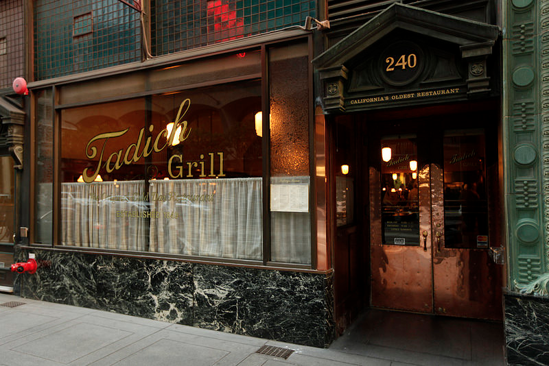 """<p>The Art Deco vibe doesn't just remain on the outside of this <a href=""""https://www.tripadvisor.com/Restaurant_Review-g60713-d353920-Reviews-Tadich_Grill-San_Francisco_California.html"""" rel=""""nofollow noopener"""" target=""""_blank"""" data-ylk=""""slk:San Francisco restaurant"""" class=""""link rapid-noclick-resp"""">San Francisco restaurant</a>. Inside, the high ceilings, wood paneling, and majestic bar transport patrons back to 1849. They don't take reservations, but customers flock here for fresh seafood anyway.</p>"""