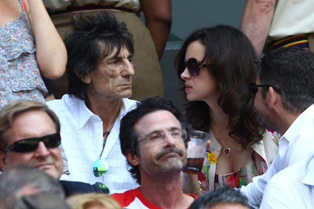 LONDON, ENGLAND - JULY 07: Ronnie Wood and Sally Humphreys attend the Gentlemen's Singles Final match between Andy Murray of Great Britain and Novak Djokovic of Serbia on day thirteen of the Wimbledon Lawn Tennis Championships at the All England Lawn Tennis and Croquet Club on July 7, 2013 in London, England. (Photo by Clive Brunskill/Getty Images)