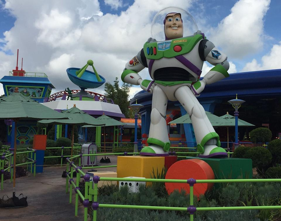 A 14-foot-tall Buzz Lightyear stands watch outside Alien Swirling Saucers in Toy Story Land at Disney's Hollywood Studios.