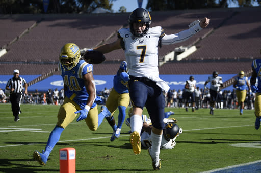 California quarterback Chase Garbers, center, runs in for a touchdown during the first half of an NCAA college football game against UCLA in Los Angeles, Sunday, Nov. 15, 2020. (AP Photo/Kelvin Kuo)