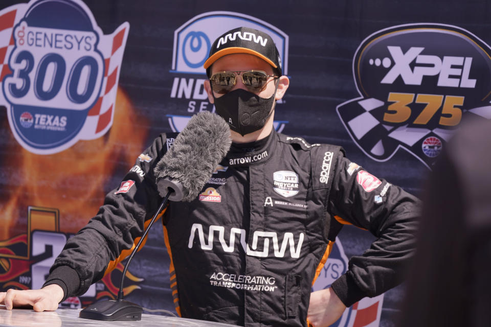 Pato O'Ward of Mexico speaks to reporters after driving during IndyCar auto race testing at Texas Motor Speedway in Fort Worth, Texas, Wednesday, March 31, 2021. (AP Photo/LM Otero)