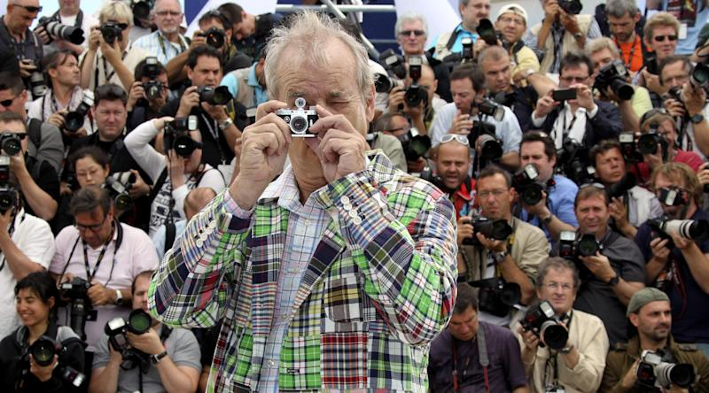 Actor Bill Murray plays with a camera during a photo call for Moonrise Kingdom at the 65th international film festival, in Cannes, southern France, Wednesday, May 16, 2012. (AP Photo/Joel Ryan)