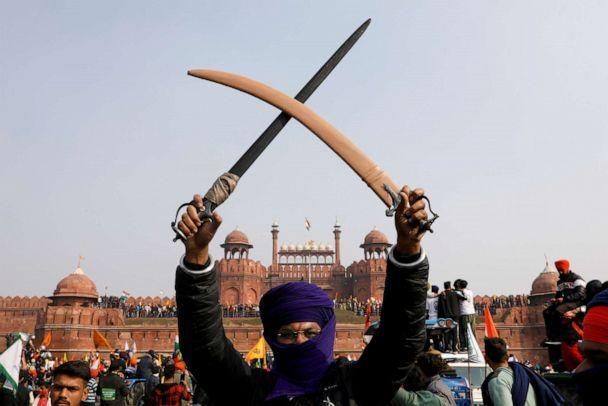 PHOTO: A farmer holds swords during a protest against farm laws introduced by the government at the historic Red Fort in New Delhi, Jan. 26, 2021. (Adnan Abidi/Reuters)