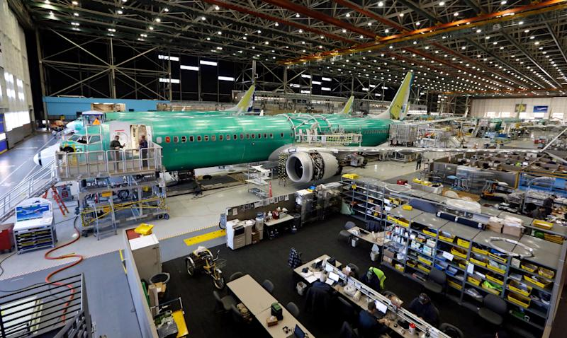 The first of the large Boeing 737 MAX 9 models sits at the front of the assembly line and almost ready to roll out at the company's airplane production facility Monday, Feb. 13, 2017, in Renton, Wash. Boeing plans to deliver its first 737 MAX airplane by May. Boeing has already built 13 of the initial MAX 8 models, which are awaiting FAA certification. (AP Photo/Elaine Thompson)