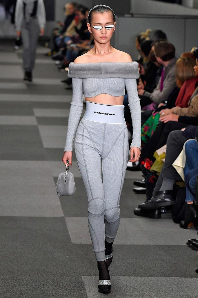<p>Model walks in the Alexander Wang FW18 show wearing reflective sunglasses made in collaboration with Gentle Monster. (Photo: Getty) </p>