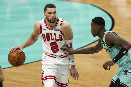 Chicago Bulls guard Zach LaVine (8) brings the ball upcourt while guarded by Charlotte Hornets guard Terry Rozier (3) during the second half of an NBA basketball game in Charlotte, N.C., Friday, Jan. 22, 2021. (AP Photo/Jacob Kupferman)