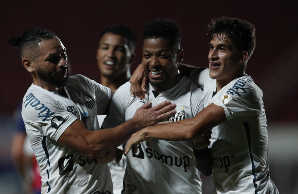Brazil's Santos Marinho (C) celebrates with teammates after scoring a penalty kick during the Copa Libertadores football tournament qualifying round match against Argentina's San Lorenzo at the Pedro Bidegain Stadium, also known as Nuevo Gasometro, in Buenos Aires, on April 6, 2021. (Photo by Natacha Pisarenko / POOL / AFP) (Photo by NATACHA PISARENKO/POOL/AFP via Getty Images)
