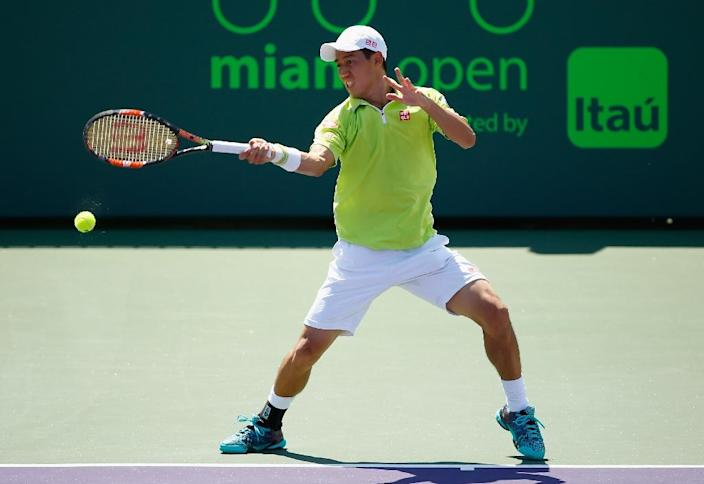 Kei Nishikori of Japan returns the ball against Viktor Troicki of Serbia during the Miami Open on March 30, 2015 in Key Biscayne, Florida (AFP Photo/Al Bello)