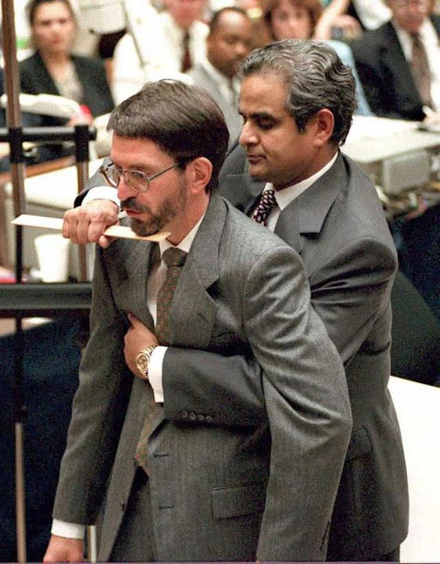 <p>Los Angeles County Coroner Dr. Lakshmanan Sathyavagiswaram (R) demonstrates on prosecutor Brian Kelberg (L) the fatal stab wound to victim Ronald Goldman during the O.J. Simpson murder trial in Los Angeles, Calif., June 13, 1995. (Photo: Myung J. Chun/AFP/Getty Images) </p>