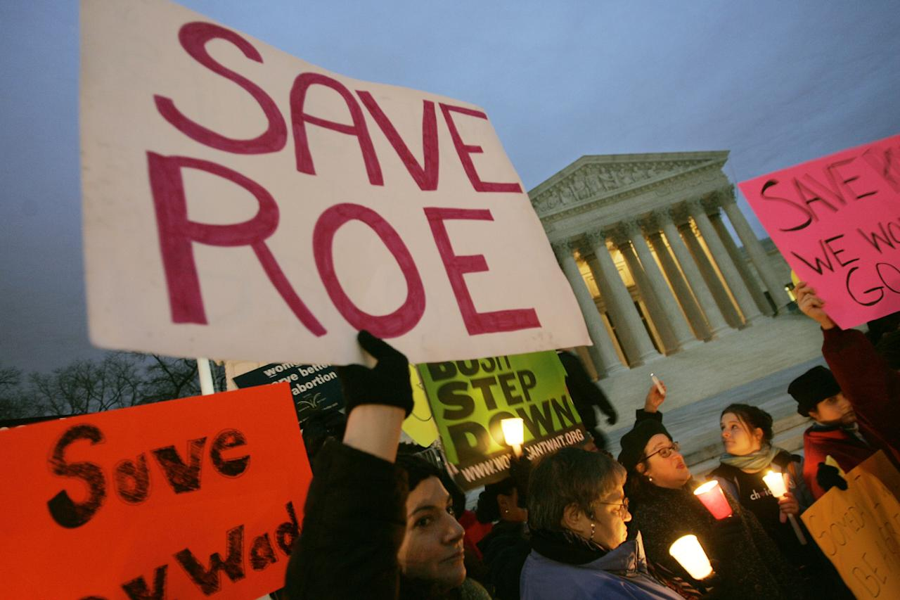 Pro-choice supporters hold a candlelight vigil infront of the Supreme Court Building Sunday, Jan. 22, 2005 in Washington. It was 33-years ago today that the Supreme Court decision of Roe versus Wade made abortion legal. (AP Photo/Pablo Martinez Monsivais)