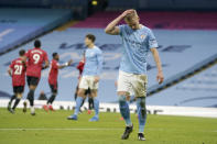 Manchester City's Oleksandr Zinchenko reacts after Manchester United's Luke Shaw scored his side's second goal during the English Premier League soccer match between Manchester City and Manchester United at the Etihad Stadium in Manchester, England, Sunday, March 7, 2021. (Dave Thompson/Pool via AP)